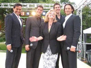 Beverly Thomson smiles as she poses with Il Divo.